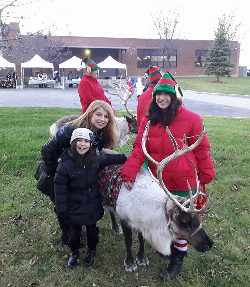 Citizens posing with a reindeer